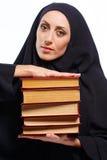 Beautiful Muslim woman holding a book Stock Photos