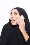 Beautiful Muslim woman holding a cellphone Stock Images