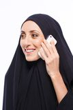 Beautiful Muslim woman holding a cellphone Royalty Free Stock Photography