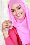 Beautiful muslim woman holding a glass Stock Photography