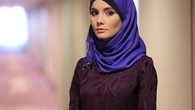 Beautiful Muslim woman in hotel corridor stock footage