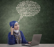 Beautiful muslim woman think on abstract cloud Royalty Free Stock Photo
