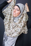 Beautiful muslim woman trying colorful scarf Royalty Free Stock Photography