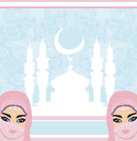 Beautiful muslim women on mosque background. Stock Images