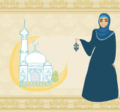 Beautiful muslim women on mosque background. Royalty Free Stock Images