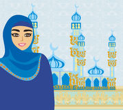 Beautiful muslim women on mosque background. Royalty Free Stock Photo