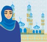 Beautiful muslim women on mosque background. Royalty Free Stock Photo