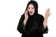 Beautiful Muslim young woman wear Hijab with happy face make a call using her mobile phone Royalty Free Stock Photo