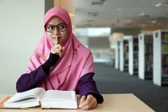 Beautiful young student in the library