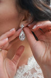 Beautiful, mysterious bride puts earrings. wonderful Wedding accessories Stock Photos