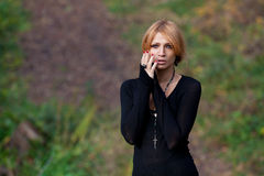 Beautiful mysterious girl in the autumn forest Royalty Free Stock Image