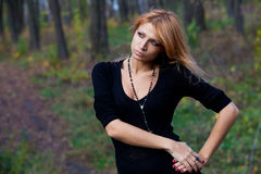 Beautiful mysterious girl in the autumn forest Royalty Free Stock Photography