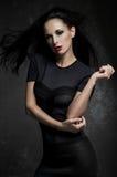 Beautiful, mysterious woman in black dress Stock Photo