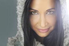 Beautiful mysterious woman. Portrait of a beautiful mysterious woman whith a hood Royalty Free Stock Image