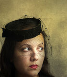 A beautiful mysterious woman wearing hat and veil Royalty Free Stock Images