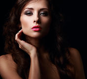 Beautiful mystery woman face kissing her hot pink lips Royalty Free Stock Photography