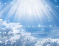 Mystical divine angelic background with divine rays of light. Beautiful mystical divine angelic magic blue background with stars, mystic rays of light over cloud royalty free stock image