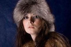 The beautiful mystical women  in fur-cap Royalty Free Stock Image