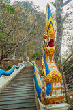 Beautiful naga head sculpture on the stairs leading up the templ Royalty Free Stock Photography