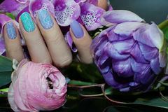 Beautiful Nail Art Manicure with flowers.Nail Care. Beautiful Nail Art Manicure with flowers. Nail designs. Nail Care And Manicure Stock Photography