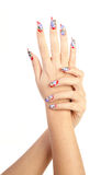 Beautiful nails. Two hands with beautiful nails unusual shape on white background stock image