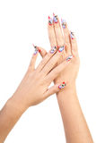 Beautiful nails. Two hands with beautiful nails unusual shape on white background royalty free stock photo