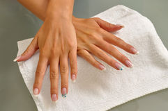 Beautiful nails on white towel. Beautiful woman's nails on white towel Royalty Free Stock Photo