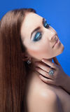 Beautiful naked girl with bright blue makeup and jewelery Royalty Free Stock Photos