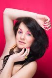 Beautiful naked girl with bright makeup and long curly hair Royalty Free Stock Photos