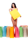 Beautiful naked girl with a shopping bag Stock Photos