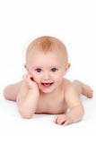 Beautiful naked laughing cuddly blue eyed baby girl Royalty Free Stock Photos