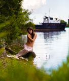 Beautiful naked, sexual mermaid on the river bank Stock Photo