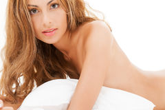 Beautiful naked woman in the bed. Health and beauty concept - beautiful naked woman in the bed Royalty Free Stock Photography