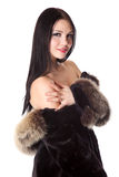 A beautiful naked woman with a fur coat Stock Images