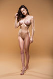 Beautiful Naked Woman Isolated On The Beige Background Stock Photo