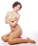Beautiful naked woman poses covering itself hands Royalty Free Stock Images