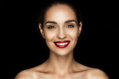 Beautiful naked woman with red lips looking at camera. Isolated on black Royalty Free Stock Image
