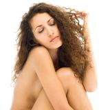 Beautiful naked woman in sad mood. Portrait of the beautiful naked woman in sad mood Stock Image