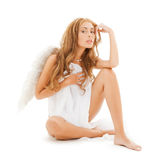 Beautiful naked woman with white angel wings. Health and beauty concept - beautiful naked woman with white angel wings Royalty Free Stock Images