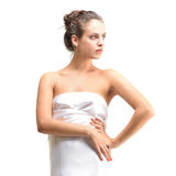 Beautiful naked woman in a white towel. Royalty Free Stock Photography