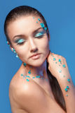 Beautiful naked young woman covered with blue crystals Stock Photos