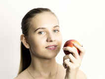 Beautiful naked young woman eating an apple. healthy food - strong teeth concept Stock Photography