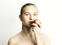 Beautiful naked young woman eating an apple. healthy food - strong teeth concept Royalty Free Stock Photography