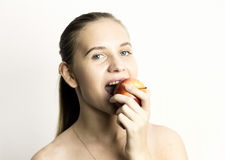 Beautiful naked young woman eating an apple. healthy food - strong teeth concept Stock Photos