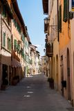 Narrow street with old facades in a tuscany village - Italy. Beautiful narrow street with old facades in a tuscany village - Italy Stock Photos