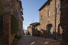 Beautiful narrow street in the small magical and old village of Pienza, Tuscany stock photos