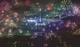 Beautiful national monument with burst fireworks. Beautiful aerial view of national monument with burst fireworks during new years eve celebration in Jakarta Royalty Free Stock Photo