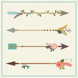 Beautiful native american arrows, feathers and floral decoration Stock Photo