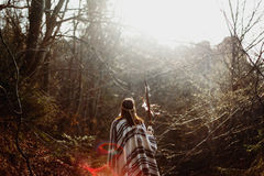 Beautiful native indian american woman walking on background of. Light woods stock image