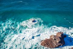 Beautiful natural abstract background, turquoise water and waves. Are broken against a stone. Cabo da Roca, Portugal. The power of the ocean Royalty Free Stock Photos